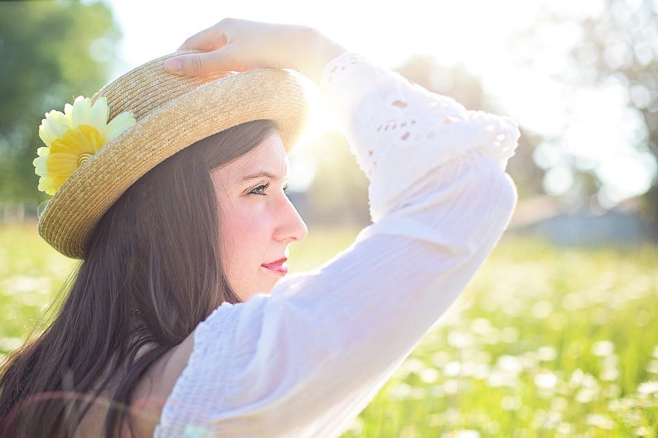 Woman Wearing Hat in a Field Image
