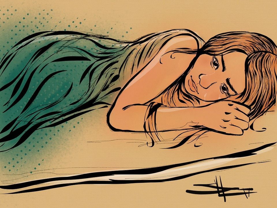 Crying Woman in Bed Image
