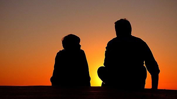 Couple Sitting at Sunset Image