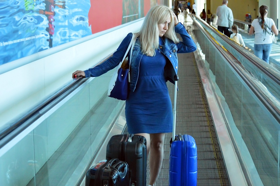 Woman stressed inside airport image