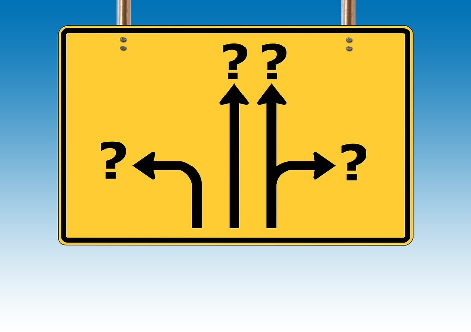 Road Sign Pointing to Question Marks Image