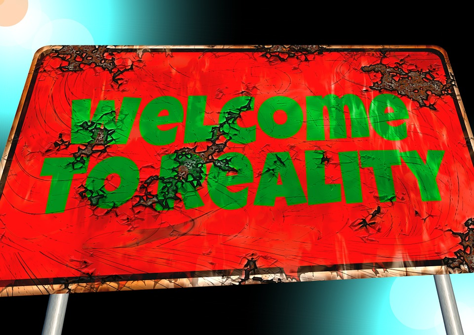 """Sign Saying """"Welcome to Reality"""" Image"""