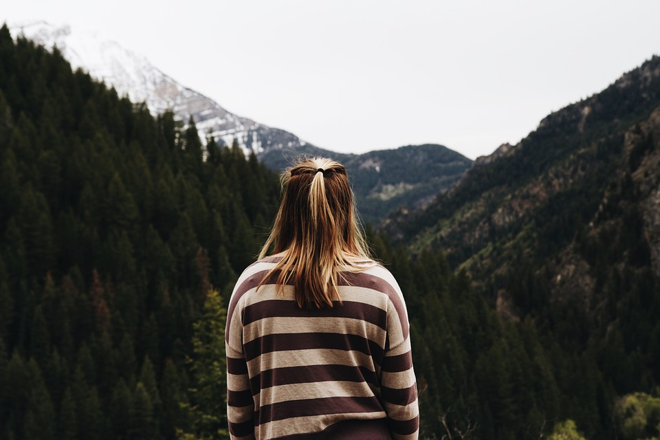 Girl looking out to the mountains image