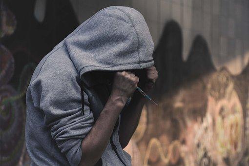 Upset Person Holding a Syringe Image