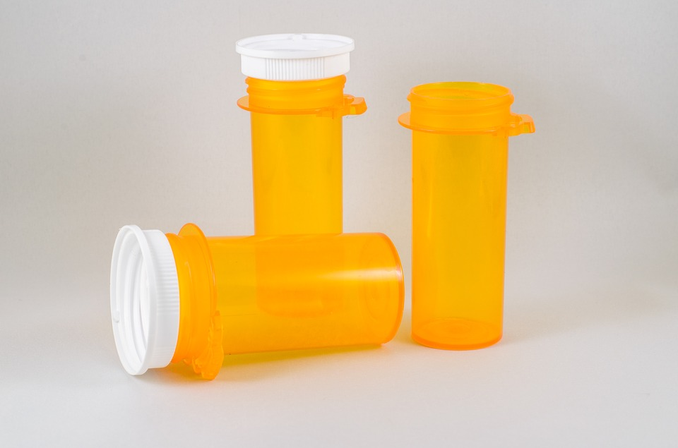 empty prescription bottles image
