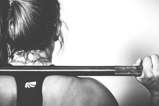 Woman Lifting Weight Image