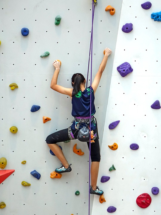 Woman rock climbing image