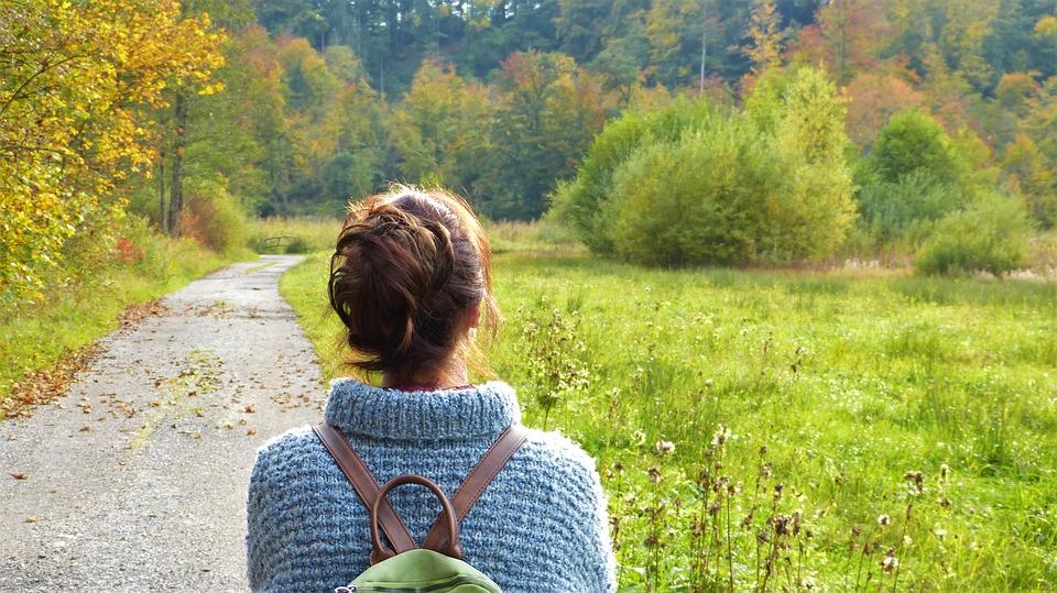 Woman walking down a path image