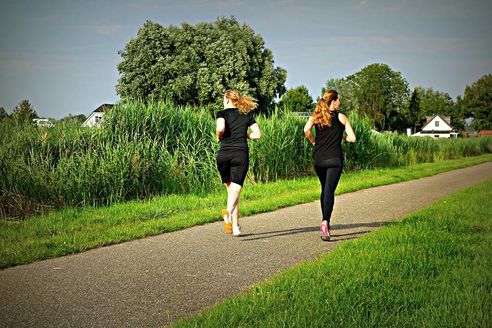 two women jogging image