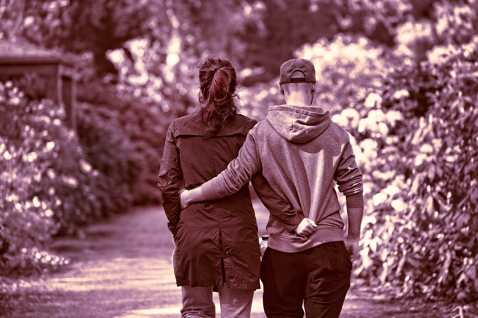 Couple Walking With Arms Around Eachother Image
