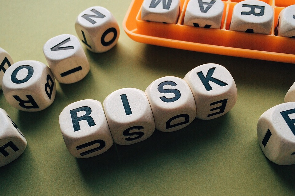 """""""Risk"""" spelled out of beads"""