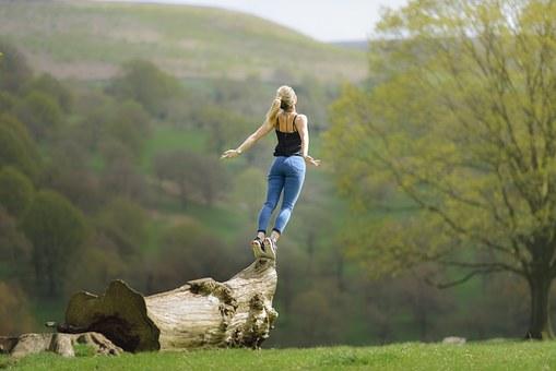 Woman Balancing on a Log Image