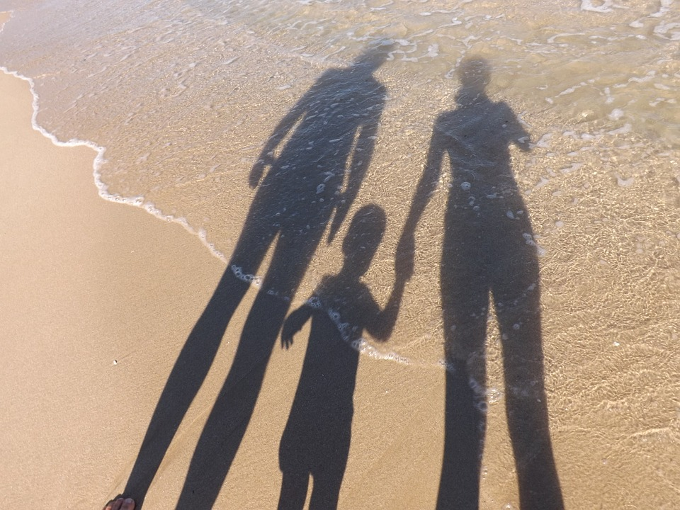 family shadow in sand image