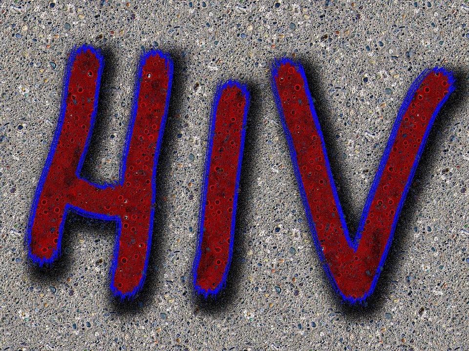 Grafitti saying HIV on Sidewalk Image