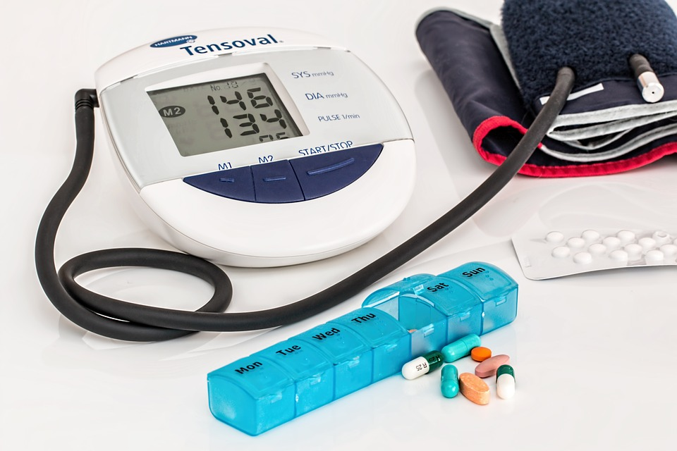 Blood pressure monitor and pill holder image