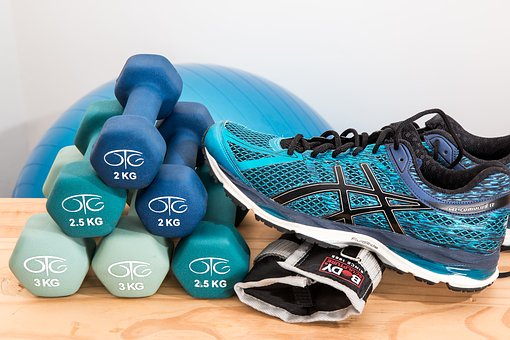 Hand Weights and Running Shoes Image