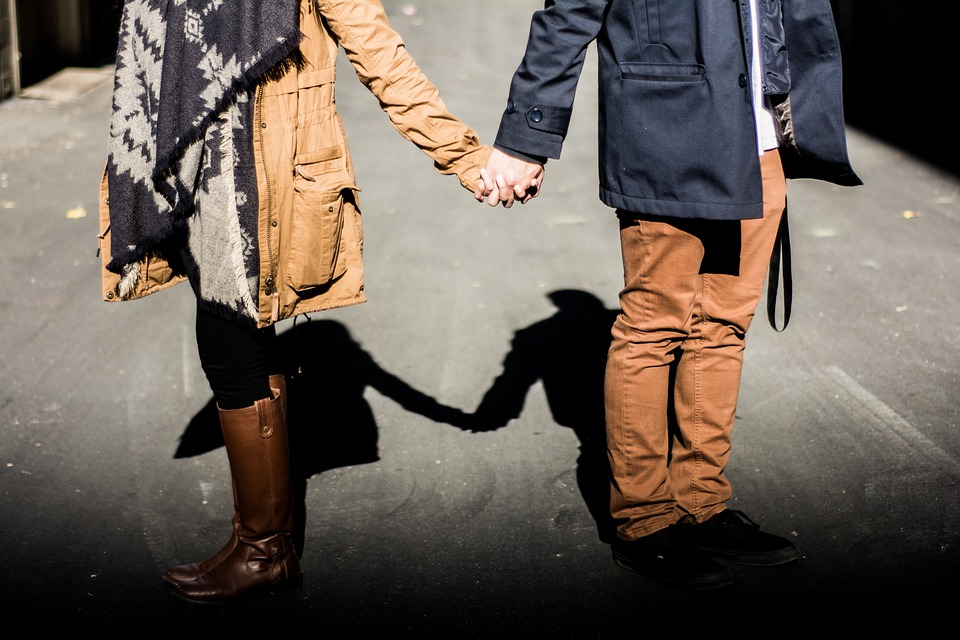 couple holding hands image