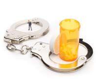 handcuffs around a pill bottle image