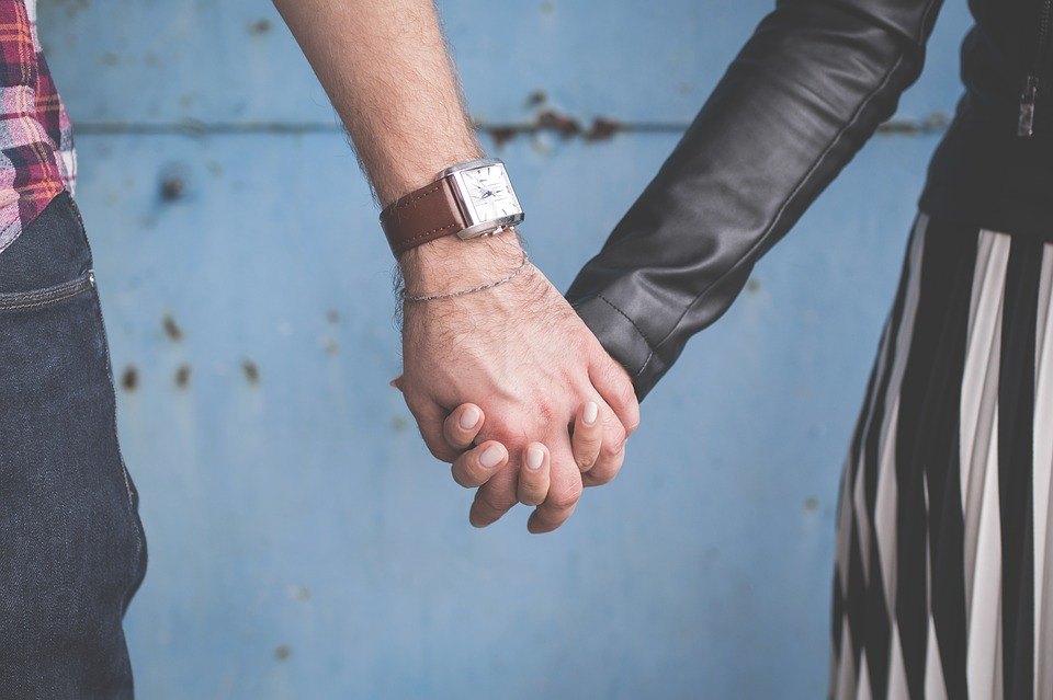 people holding hands image