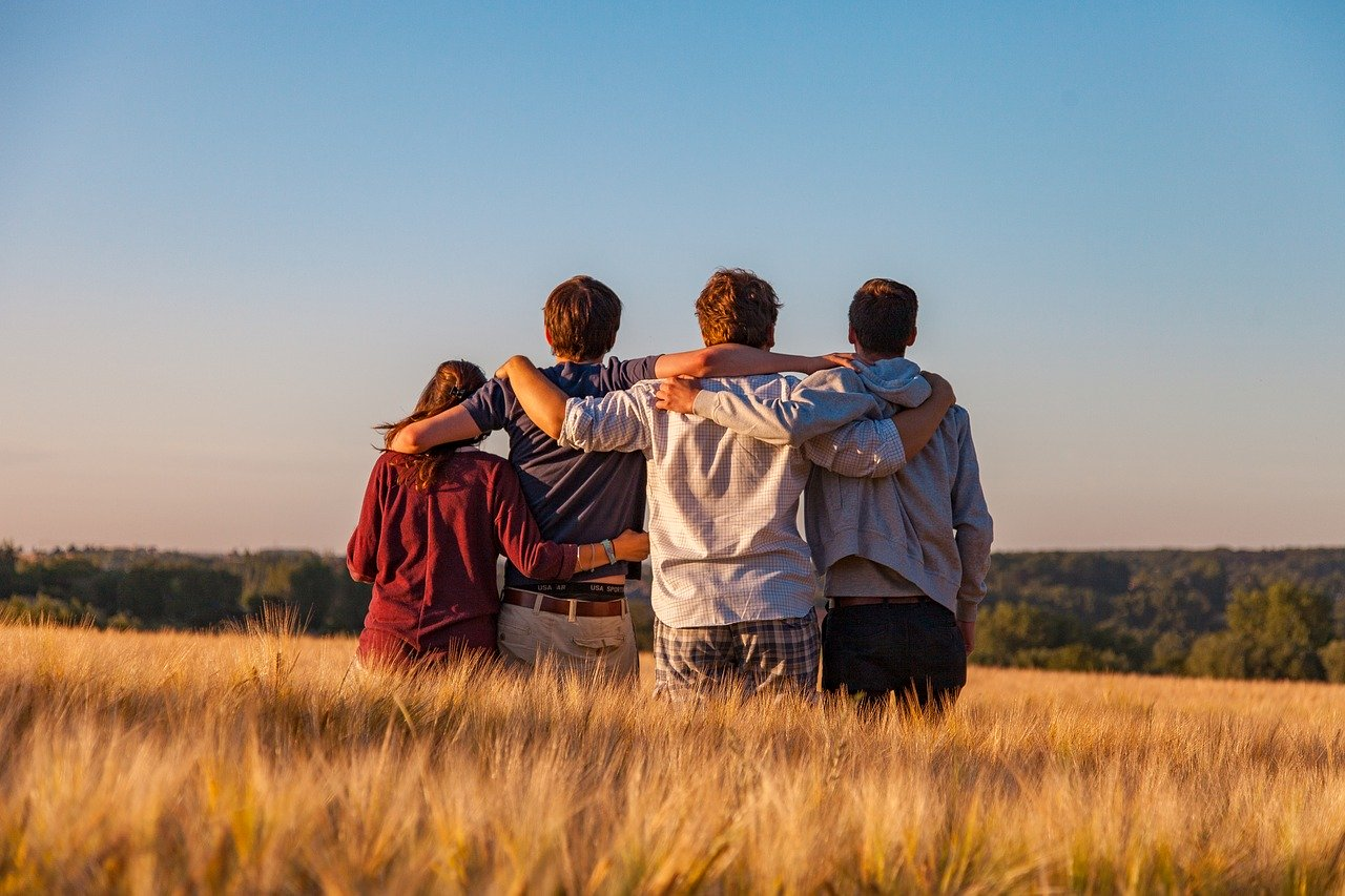 group of teens in a field. links to article