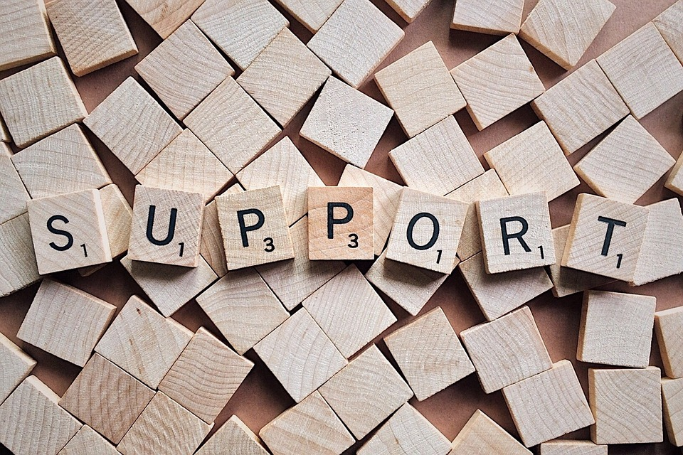 """""""Support"""" spelled out of scrabble tiles image"""