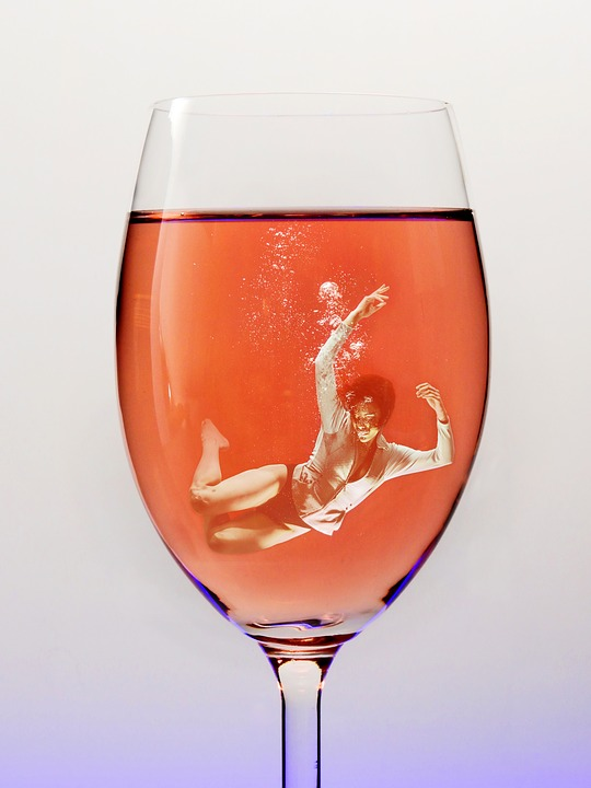 woman drowning in a wine glass image