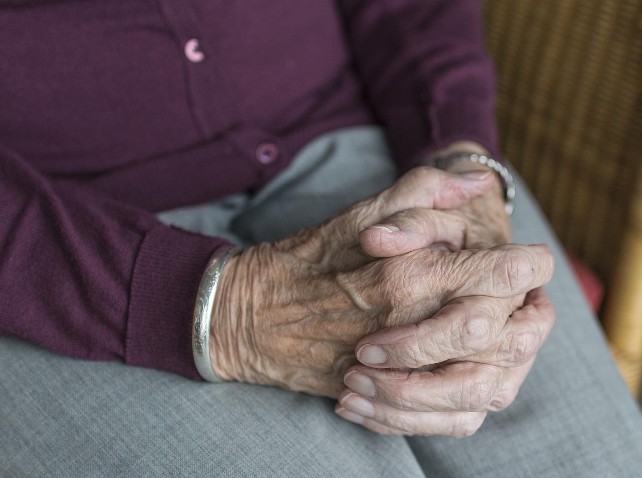 elderly woman's hands links to article