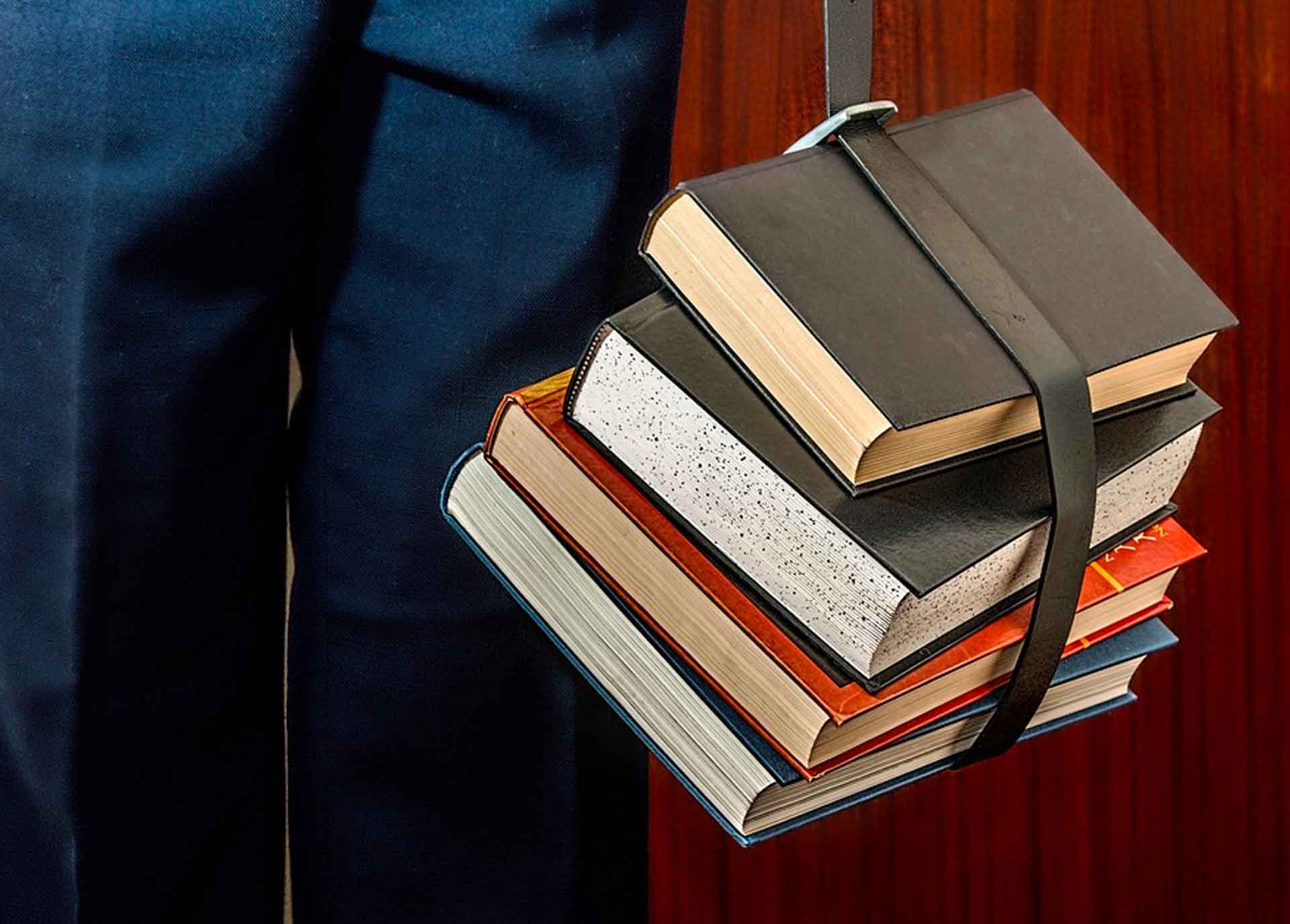 Person with a stack of books